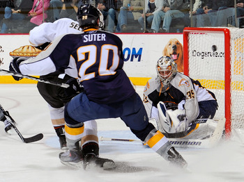 NASHVILLE, TN - MARCH 24: Teemu Selanne #8 of the Anaheim Ducks fights through the defense of Ryan Suter #20 of the Nashville Predators and scores a goal against goalie Pekka Rinne #35 of the Predators on March 24, 2011 at the Bridgestone Arena in Nashvil