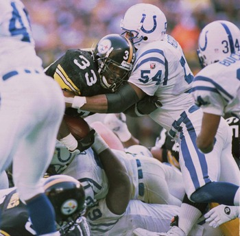 14 JAN 1996:  RUNNING BACK #33 BAM MORRIS OF THE PITTSBURGH STEELERS MUSCLES HIS WAY PAST JEFF HERROD #54 OF THE INDIANAPOLIS COLTS AND OTHER COLT DEFENSE FOR THE GAME WINNING TOUCHDOWN IN THE AFC CHAMPIONSHIP GAME AT THREE RIVERS STADIUM, PITTSBURGH, PEN