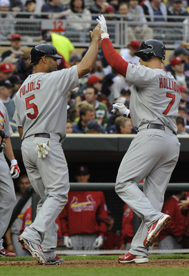 MINNESOTA, MN - APRIL 2: Albert Pujols #5 and Matt Holliday #7 of St. Louis Cardinals celebrate Holliday's fourth inning two-run homerun against the Minnesota Twins during an exhibition game at Target Field on April 2, 2010 in Minneapolis, Minnesota. Card