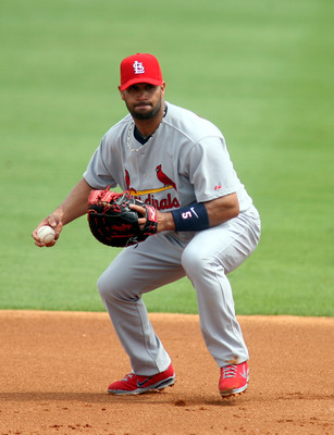 JUPITER, FL - MARCH 06:  First baseman Albert Pujols #5 of the St. Louis Cardinals plays against the Florida Marlins at Roger Dean Stadium on March 6, 2011 in Jupiter, Florida.  (Photo by Marc Serota/Getty Images)