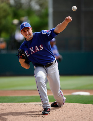 GLENDALE, AZ - MARCH 15:  Pitcher of Derek Holland #45 of the Texas Rangers  throws a pitch against the Los Angeles Dodgers during the spring training baseball game at Camelback Ranch on March 15, 2011 in Glendale, Arizona.  (Photo by Kevork Djansezian/Ge