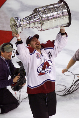 9 Jun 2001:  Ray Bourque #77 of the Colorado Avalanche skates away with the Stanley Cup after 22 seasons in pursuit of the NHL Stanley Cup Championship. Denver, Colorado.  DIGITAL IMAGE.  Mandatory Credit: Brian Bahr/ALLSPORT