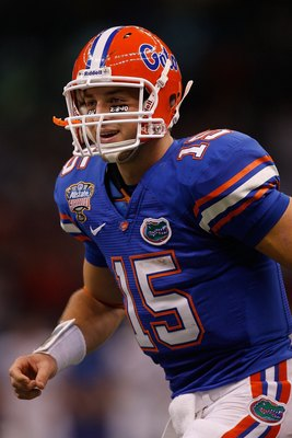 NEW ORLEANS - JANUARY 01:  Tim Tebow #15 of the Florida Gators reacts after a touchdown against the Cincinnati Bearcats during the Allstate Sugar Bowl at the Louisana Superdome on January 1, 2010 in New Orleans, Louisiana.  (Photo by Chris Graythen/Getty