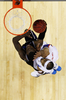 NEW ORLEANS, LA - MARCH 26:  Shelvin Mack #1 of the Butler Bulldogs shoots against Alex Tyus #23 of the Florida Gators during the Southeast regional final of the 2011 NCAA men's basketball tournament at New Orleans Arena on March 26, 2011 in New Orleans,