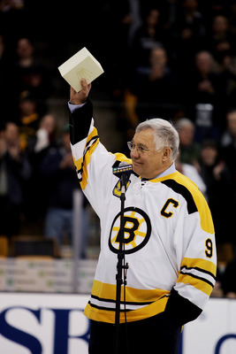 BOSTON - FEBRUARY 13:  Former Boston Bruins player John Bucyk acknowledges the crowd during the ceremony honoring his 50 years with the Bruins organization before the game against the Edmonton Oilers on February 13, 2007 at TD Banknorth Garden in Boston,