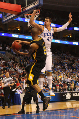 PHILADELPHIA - MARCH 19:  Eric Maynor #3 of the VCU Rams passes against Nikola Dragovic #41 of the UCLA Bruins during the first round of the NCAA Division I Men's Basketball Tournament at the Wachovia Center on March 19, 2009 in Philadelphia, Pennsylvania