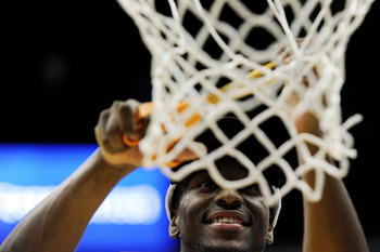 ANAHEIM, CA - MARCH 26:  Kemba Walker #15 of the Connecticut Huskies cuts down the net after defeating the Arizona Wildcats during the west regional final of the 2011 NCAA men's basketball tournament at the Honda Center on March 26, 2011 in Anaheim, Calif