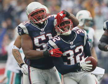 FOXBORO, MA - JANUARY 02: Devin McCourty #32 of the New England Patriots is congratulated by teammate Jerod Mayo #51 after McCourty intercepted a pass by the Miami Dolphins on January 2, 2011 at Gillette Stadium in Foxboro, Massachusetts.  (Photo by Elsa/