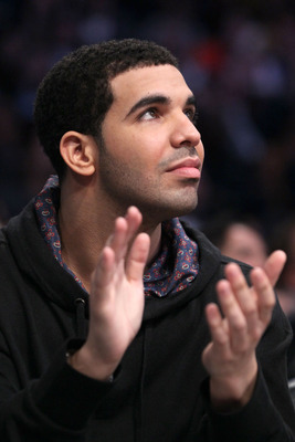 LOS ANGELES, CA - FEBRUARY 20:  Rapper Drake sits in the audience during the 2011 NBA All-Star game at Staples Center on February 20, 2011 in Los Angeles, California. NOTE TO USER: User expressly acknowledges and agrees that, by downloading and or using t