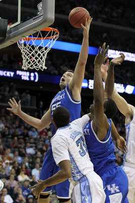 NEWARK, NJ - MARCH 27:  Josh Harrellson #55 of the Kentucky Wildcats in action against the North Carolina Tar Heels during the east regional final of the 2011 NCAA men's basketball tournament at Prudential Center on March 27, 2011 in Newark, New Jersey.