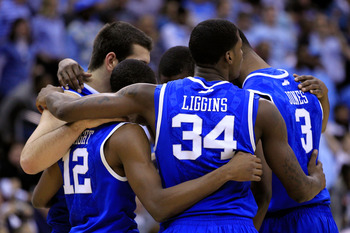 NEWARK, NJ - MARCH 27:  DeAndre Liggins #34 of the Kentucky Wildcats hugs teammates Brandon Knight #12 and Terrence Jones #3 during their game against the North Carolina Tar Heels in the east regional final of the 2011 NCAA men's basketball tournament at