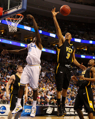 PHILADELPHIA - MARCH 19:  Eric Maynor #3 of the VCU Rams rebounds against Jrue Holiday #21 of the UCLA Bruins during the first round of the NCAA Division I Men's Basketball Tournament at the Wachovia Center on March 19, 2009 in Philadelphia, Pennsylvania.