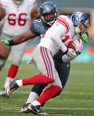 SEATTLE - NOVEMBER 07:  Defensive tackle E.J. Wilson #97 of the Seattle Seahawks tackles Steve Smith #12 of the New York Giants at Qwest Field on November 7, 2010 in Seattle, Washington. The Giants defeated the Seahawks 41-7. (Photo by Otto Greule Jr/Gett