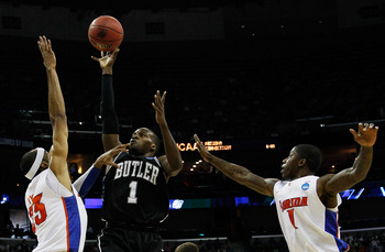 NEW ORLEANS, LA - MARCH 26:  Shelvin Mack #1 of the Butler Bulldogs shoots over Alex Tyus #23 and Kenny Boynton #1 of the Florida Gators in the first half during the Southeast regional final of the 2011 NCAA men's basketball tournament at New Orleans Aren