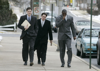 LEBANON - JANUARY 14: New York Giants wide receiver Plaxico Burress, right, walks with members of his legal team as he arrives at the Lebanon County Courthouse January 14, 2009 in Lebanon, Pa.  Burress is scheduled to appear in a civil trial in a dispute