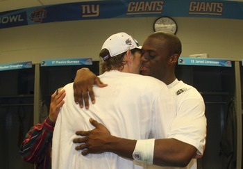 GLENDALE, AZ - FEBRUARY 03:  Wide receiver Plaxico Burress #17 of the New York Giants in (R) hugs quarterback Eli Manning #10 the locker room after defeating the New England Patriots 17-14 during Super Bowl XLII on February 3, 2008 at the University of Ph