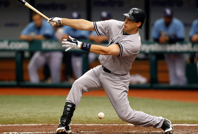 ST PETERSBURG, FL - APRIL 11:  First baseman Mark Teixeira #25 of the New York Yankees fouls off a pitch against the Tampa Bay Rays during the game at Tropicana Field on April 11, 2010 in St. Petersburg, Florida.  (Photo by J. Meric/Getty Images)