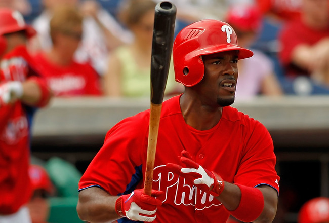 CLEARWATER, FL - MARCH 06:  Shortstop Jimmy Rollins #11 of the Philadelphia Phillies fouls off a pitch against the Tampa Bay Rays during a Grapefruit League Spring Training Game at Bright House Field on March 6, 2011 in Sarasota, Florida.  (Photo by J. Me
