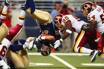 ST. LOUIS - SEPTEMBER 26: Danny Amendola #16 of the St. Louis Rams is flipped upside down against Chris Wilson #95 and H.B. Blades #54 both of the Washington Redskins at the Edward Jones Dome on September 26, 2010 in St. Louis, Missouri.  The Rams beat th