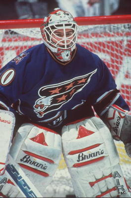 29 NOV 1995:  GOALKEEPER JIM CAREY OF THE WASHINGTON CAPITALS SITS IN GOAL DURING THE CAPITALS 2-2 TIE WITH THE ANAHEIM MIGHTY DUCKS AT THE POND IN ANAHEIM, CALIFORNIA.   Mandatory Credit: Glenn Cratty/ALLSPORT