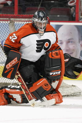 RALEIGH, NC - NOVEMBER 5:  Roman Cechmanek #32 of the Philadelphia Flyers in goal against the Carolina Hurricanes on November 5, 2002 at the RBC Center in Raleigh, North Carolina.  (Photo by Craig Jones/Getty Images/NHLI)
