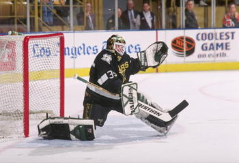 4 Apr 1997:  Goaltender Andy Moog of the Dallas Stars blocks a shot during a game against the Los Angeles Kings at the Great Western Forum in Inglewood, California.  The game was a tie, 3-3. Mandatory Credit: Elsa Hasch  /Allsport