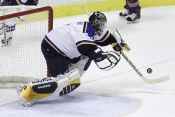 16 May 2001:  Roman Turek #1 of the St. Louis Blues falls on the puck to make a save against the Colorado Avalanche in the second period during Game 3 of the Western Conference finals at the Savvis Center in St. Louis, Missouri.  DIGITAL IMAGE Mandatory C