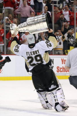 DETROIT - JUNE 12: Marc-Andre Fleury #29 of the Pittsburgh Penguins celebrates with the Stanley Cup after defeating the Detroit Red Wings by a score of 2-1 to win Game Seven and the 2009 NHL Stanley Cup Finals at Joe Louis Arena on June 12, 2009 in Detroi