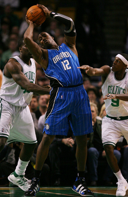 BOSTON - NOVEMBER 20: Dwight Howard #12 of the Orlando Magic draws a double team by Kendrick Perkins #43 and Rajon Rondo #9 of the Boston Celtics during the game on November 20, 2009 at the TD Garden in Boston, Massachusetts. NOTE TO USER: User expressly