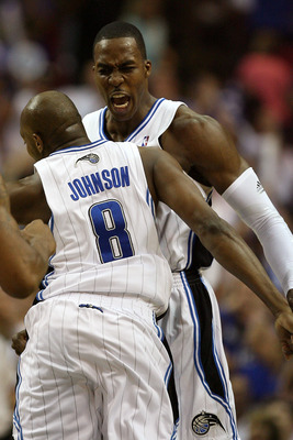 ORLANDO, FL - MAY 30: Dwight Howard #12 and Anthony Johnson #8 of the Orlando Magic celebrate after a play against the Cleveland Cavaliers in Game Six of the Eastern Conference Finals during the 2009 Playoffs at Amway Arena on May 30, 2009 in Orlando, Flo