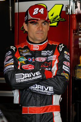 FONTANA, CA - MARCH 26:  Jeff Gordon, driver of the #24 Drive to End Hunger Chevrolet, stands in the garage area during practice for the NASCAR Sprint Cup Series Auto Club 400 at Auto Club Speedway on March 26, 2011 in Fontana, California.  (Photo by Todd