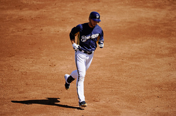 PHOENIX, AZ - MARCH 10:  Ryan Braun #8 of the Milwaukee Brewers runs the bases after hitting a three-run home run against the Colorado Rockies in the third inning of the spring training baseball game at Maryvale Baseball Park on March 10, 2011 in Phoenix,