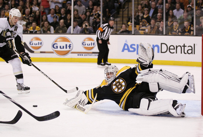 BOSTON, MA - MARCH 05:  Tim Thomas #30 of the Boston Bruins is unable to stop a pass and shot by to Jordan Staal #11 of the Pittsburgh Penguins on March 5, 2011 at the TD Garden in Boston, Massachusetts.  (Photo by Elsa/Getty Images)