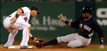 FORT MYERS, FL - MARCH 14:  Shortstop Marco Scutaro #16 of the Boston Red Sox tags out outfielder Curtis Granderson #14 of the New York Yankees as he attempts a steal during a Grapefruit League Spring Training Game at City of Palms Park on March 14, 2011