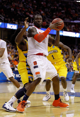 CLEVELAND, OH - MARCH 20: Rick Jackson #00 of the Syracuse Orange handles the ball against the Marquette Golden Eagles during the third of the 2011 NCAA men's basketball tournament at Quicken Loans Arena on March 20, 2011 in Cleveland, Ohio.  (Photo by Gr