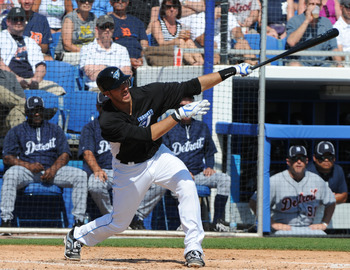 DUNEDIN, FL - FEBRUARY 26:  Infielder Jose Bautista #19 of the Toronto Blue Jays bats against the Detroit Tigers February 26, 2011 at Florida Auto Exchange Stadium in Dunedin, Florida.  (Photo by Al Messerschmidt/Getty Images)