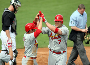 JUPITER, FL - MARCH 01:  Matt Holliday #7 of the St. Louis Cardinals celebrates his two run home run against the Florida Marlins with teammate Ryan Theriot #3 at Roger Dean Stadium on March 1, 2011 in Jupiter, Florida.  (Photo by Marc Serota/Getty Images)