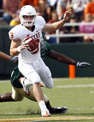 WACO, TX - NOVEMBER 14:  Quarterback Garrett Gilbert #3 of the Texas Longhorns scrambles witht he ball during the second half against the Baylor Bears on November 14, 2009 at Floyd Casey Stadium in Waco, Texas. (Photo by Tom Pennington/Getty Images)