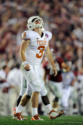 PASADENA, CA - JANUARY 07:  Quarterback Garrett Gilbert #3 of the Texas Longhorns reacts after throwing an interception to the Alabama Crimson Tide during the Citi BCS National Championship game at the Rose Bowl on January 7, 2010 in Pasadena, California.