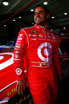 FONTANA, CA - MARCH 26:  Juan Pablo Montoya, driver of the #42 Target Chevrolet, stands in the garage area during practice for the NASCAR Sprint Cup Series Auto Club 400 at Auto Club Speedway on March 26, 2011 in Fontana, California.  (Photo by Jason Smit