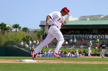 JUPITER, FL - FEBRUARY 28:  Lance Beirkman #12 of the St. Louis Cardinals hits a home run against the Florida Marlins at Roger Dean Stadium on February 28, 2011 in Jupiter, Florida.  (Photo by Marc Serota/Getty Images)