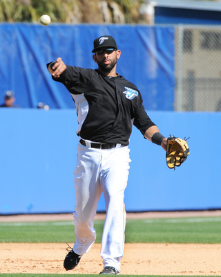 DUNEDIN, FL - FEBRUARY 26:  Infielder Jose Bautista #19 of the Toronto Blue Jays throws from third base against the Detroit Tigers February 26, 2011 at Florida Auto Exchange Stadium in Dunedin, Florida.  (Photo by Al Messerschmidt/Getty Images)