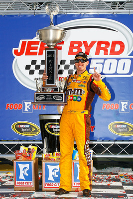 BRISTOL, TN - MARCH 20:  Kyle Busch, driver of the #18 M&M's Toyota, celebrates in Victory Lane after winning the NASCAR Sprint Cup Series Jeff Byrd 500 Presented By Food City at Bristol Motor Speedway on March 20, 2011 in Bristol, Tennessee.  (Photo by J