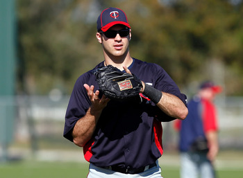 FORT MYERS, FL - FEBRUARY 23:  Catcher Joe Mauer #7 of the Minnesota Twins warms up during a spring training workout session at Hammond Stadium on February 23, 2011 in Fort Myers, Florida.  (Photo by J. Meric/Getty Images)