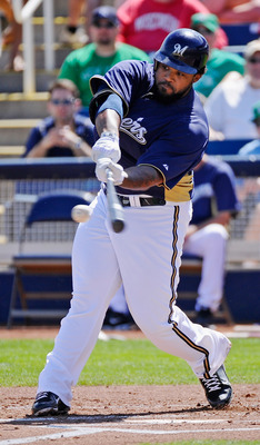 PHOENIX, AZ - MARCH 17: Prince Fielder #28 of the Milwaukee Brewers hits a basehit against pitcher Edwin Jackson #33 of the Chicago White Sox during the first inning of the spring training game at Maryvale Baseball Park on March 17, 2011 in Phoenix, Arizo
