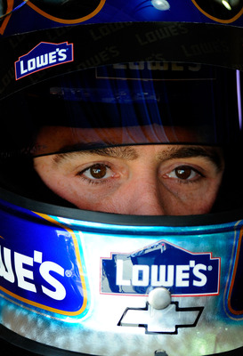 FONTANA, CA - MARCH 26:  Jimmie Johnson, driver of the #48 Lowe's Chevrolet, sits in his car during practice for the NASCAR Sprint Cup Series Auto Club 400 at Auto Club Speedway on March 26, 2011 in Fontana, California.  (Photo by Jared C. Tilton/Getty Im
