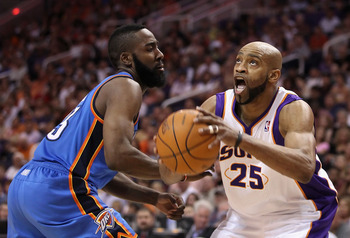PHOENIX, AZ - MARCH 30:  Vince Carter #25 of the Phoenix Suns drives to the basket against James Harden #13 of the Oklahoma City Thunder during the NBA game at US Airways Center on March 30, 2011 in Phoenix, Arizona.  The Thunder defeated the Suns 116-98.