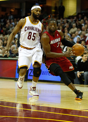 CLEVELAND - MARCH 29: Dwyane Wade #3 of the Miami Heat drives to the basket against Baron Davis #85 of the Cleveland Cavaliers during the game on March 29, 2011 at Quicken Loans Arena in Cleveland, Ohio. NOTE TO USER: User expressly acknowledges and agree