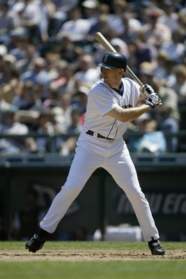 SEATTLE - JULY 1:  John Olerud #5 of the Seattle Mariners stands ready at bat during the game against the Texas Rangers on July 1, 2004 at Safeco Field in Seattle, Washington.  The Mariners defeated the Rangers 8-4.  (Photo by Otto Greule Jr/Getty Images)