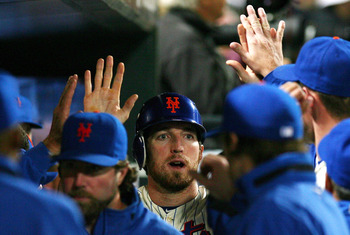 NEW YORK - SEPTEMBER 17:  Ike Davis #29 of the New York Mets celebrates after scoring a run in the second inning against the Atlanta Braves on September 17, 2010 at Citi Field in the Flushing neighborhood of the Queens borough of New York City.  (Photo by